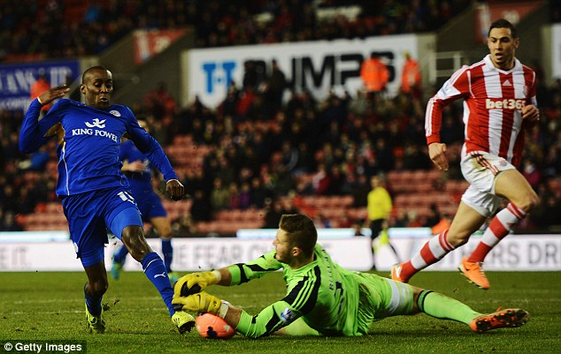 Body on the line: Stoke keeper Jack Butland dives at the feet of Leicester's Lloyd Dyer