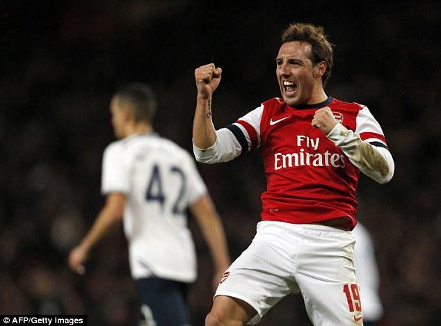 One up: Arsenal's Spanish midfielder Santi Cazorla celebrates after opening the scoring against Tottenham