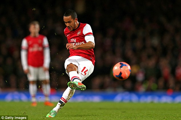 Strike: Arsenal's Theo Walcott takes a shot on goal but is unsuccessful during the FA Cup clash