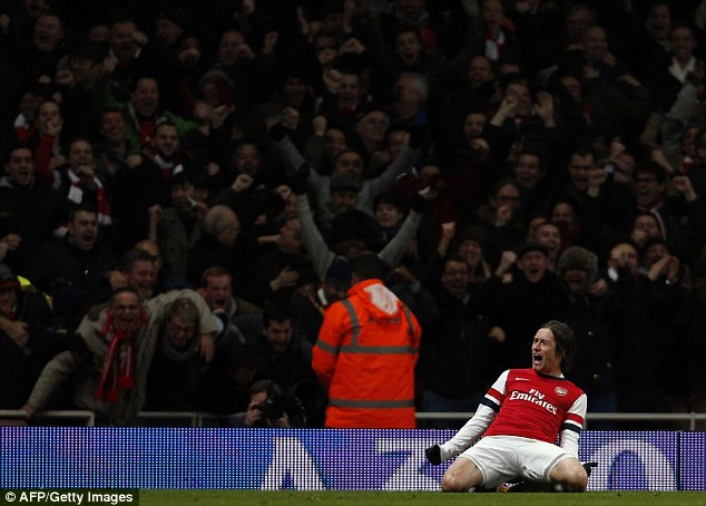 On his knees: Rosicky celebrates as Arsenal seal their place in the fourth round of the FA Cup