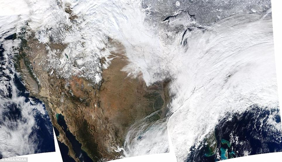 Out of this world: This NASA image taken from the Moderate Resolution Imaging Spectroradiometer shows how massive the snowstorm really was