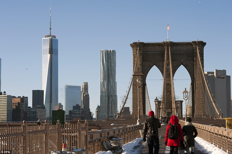 Cold morning: People walk over the Brooklyn Bridge from Brooklyn to Manhattan in New York, New York, USA, 04 January 2014. A severe winter storm dumped more than 24 inches (60 cm) of snow in some areas of Northeastern US on Thursday night