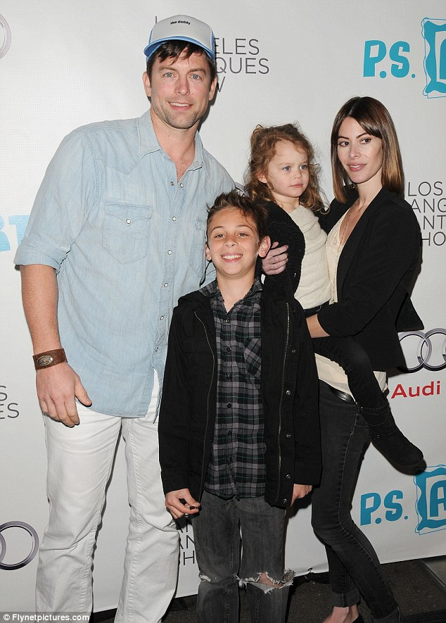 Family man: The father-of-three will celebrate his 14th wedding anniversary with wife Jaime on February 11 - seen here in 2011 with son Dylan, 11, and daughter Ella, six