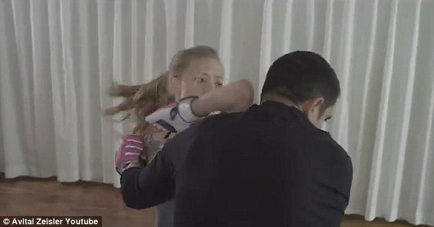 Kicking butt: The video shows Amanda demonstrating various moves on a male stand in - swinging him to the ground and even one where she manages to nab the knife from his hand