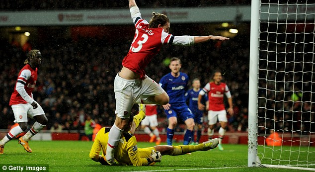 No pain, no gain: Nicklas Bendtner suffered an ankle injury scoring during Arsenal's 2-0 win over Cardiff City on New Year's Day