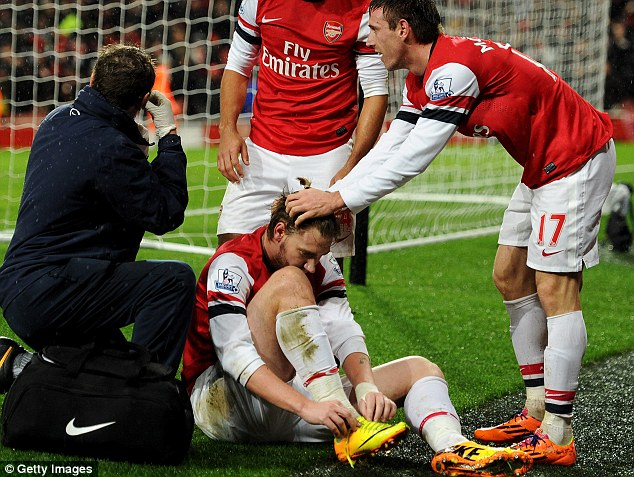 Yellow peril: Bendtner will now be missing for a month