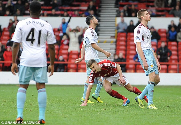 Well beaten: West Ham players look dejected as Jamie Paterson scores Forest's third on Sunday