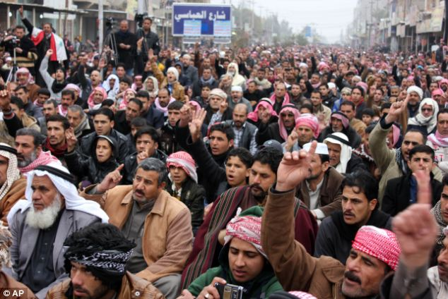 Sunni Muslim worshippers crowded streets in the city west of Baghdad after violence in nearby Ramadi