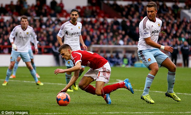 Sent crashing: Few could argue when a penalty was given for George Moncur's (right) foul on Jamie Paterson