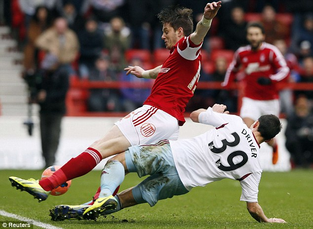 Passion of the Cup: West Ham's Callum Driver (right) goes in hard on Nottingham Forest's Greg Halford