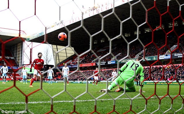 From the spot: West Ham goalkeeper Adrian was outwitted by Djamel Abdoun's confident penalty