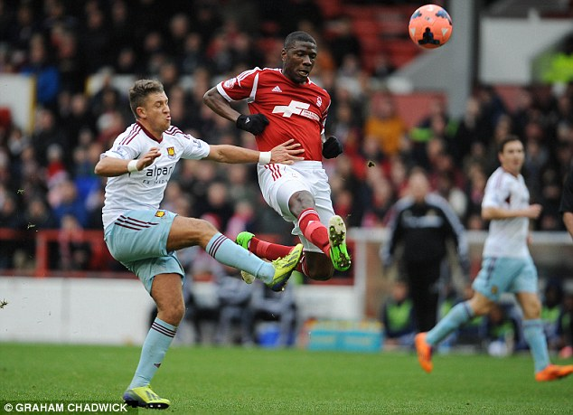 Aerial battle: Nottingham Forest's Guy Moussi and West Ham's George Moncur vie for possession