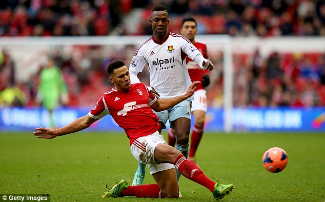 Making it count: Nottingham Forest's Jamaal Lascelles clears the ball under pressure from Modibo Maiga