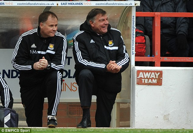 All smiles: Sam Allardyce appears to remain confident in his ability to lead West Ham
