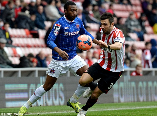 Battle: Andrea Dossena (right) challenges Carlisle's David Amoo during the FA Cup third round match