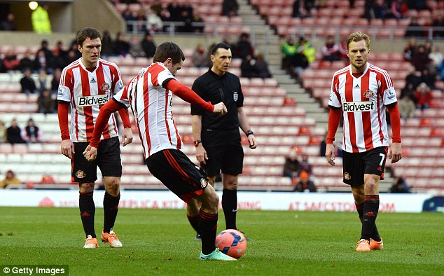 Set piece: Johnson (second left) scores Sunderland's opening goal of the game against Carlisle United