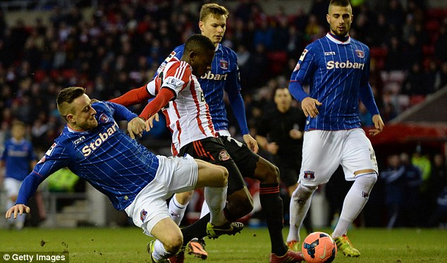 Game over: El Hadji Ba (centre) puts Sunderland 3-1 in the 89th minute against Carlisle in the FA Cup