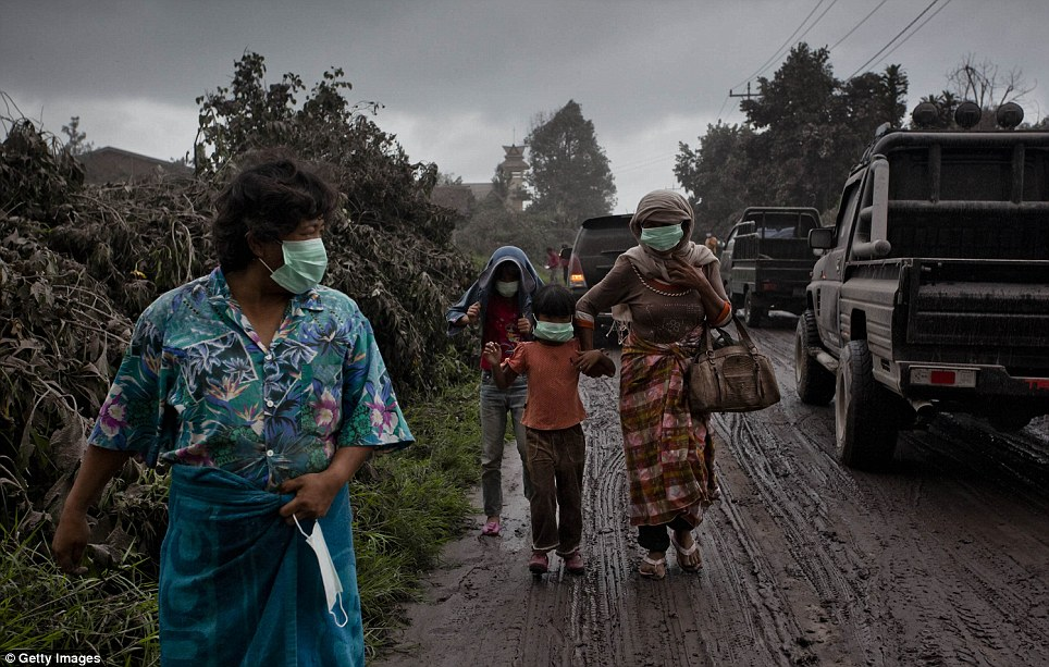 Women and children were crammed into vans that were driven down the mountain's side. Residents are being temporarily sheltered in nearby areas