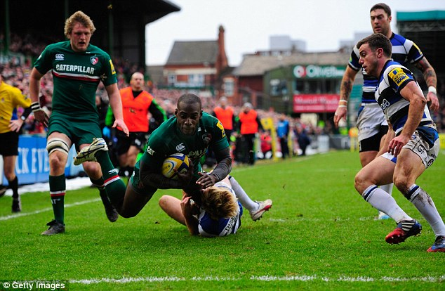 Early lead: Leicester winger Miles Benjamin dives over for the first try of the game
