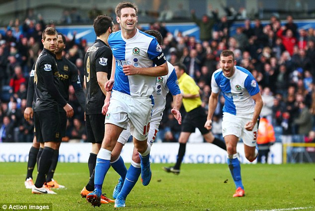 Level: Scott Dann (centre) ensured Blackburn would earn an FA Cup replay with City
