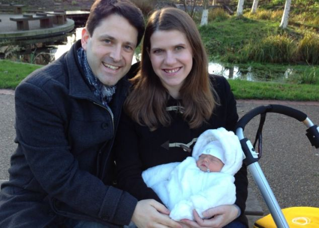 Family values: Swinson, here pictured with husband, fellow Lib Dem MP Duncan Hames, and baby Andrew