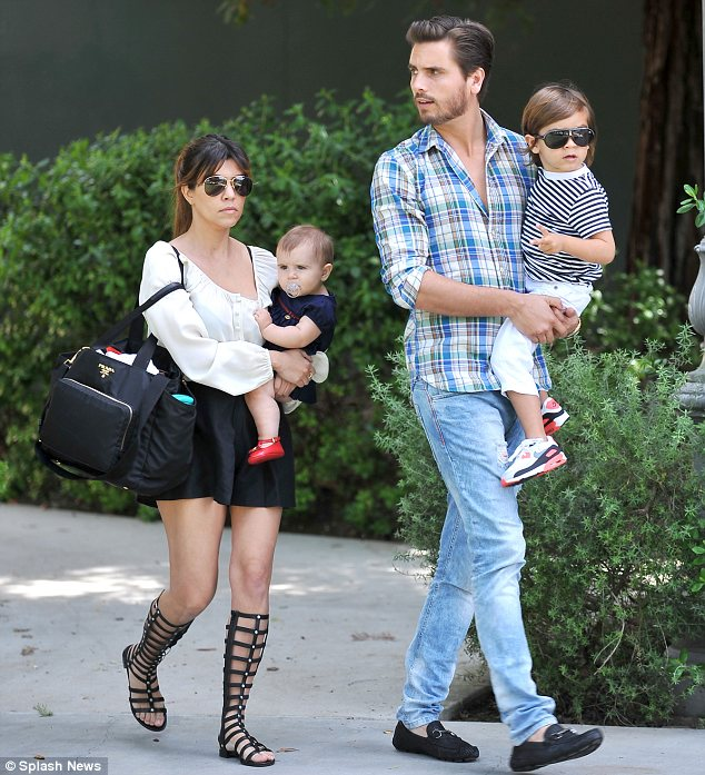 East to West: Scott was raised in Long Island with his parents but now lives in California with his partner Kourtney Kardashian and their two children Mason and Penelope
