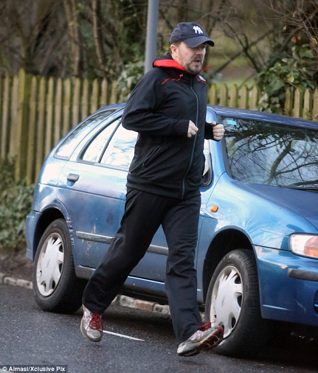Go carefully: Ricky jogged on the street through the London borough wearing a New York Yankees cap and dirty trainers