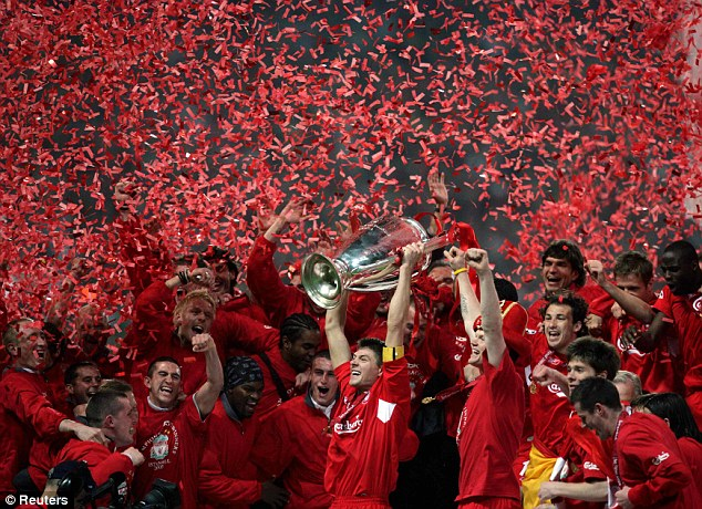 Sea of red: Liverpool Steven Gerrard holds aloft the Champions League trophy in Istanbul in 2005