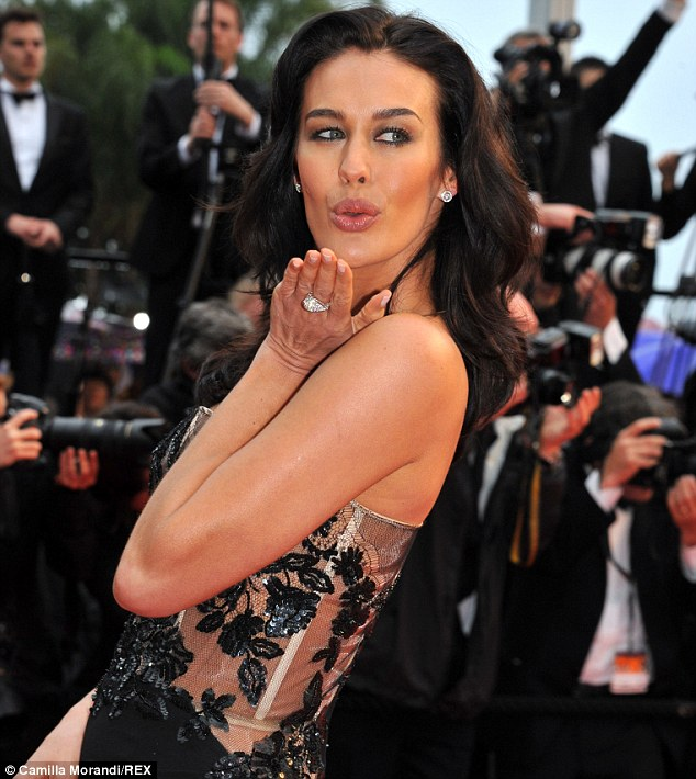 Megan Gale looking her usual glamorous self on the red carpet at Cannes Film Festival in 2013