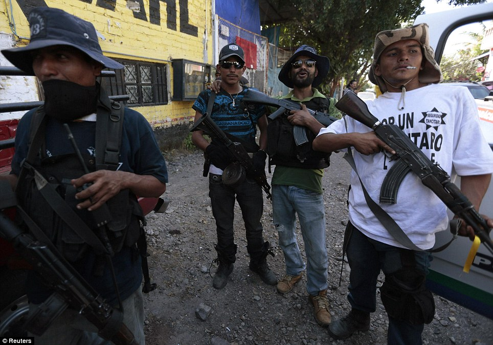 Local vigilantes armed themselves to take control of Paracuaro back - they accuse police of being in league with the gangs and say they have to protect themselves