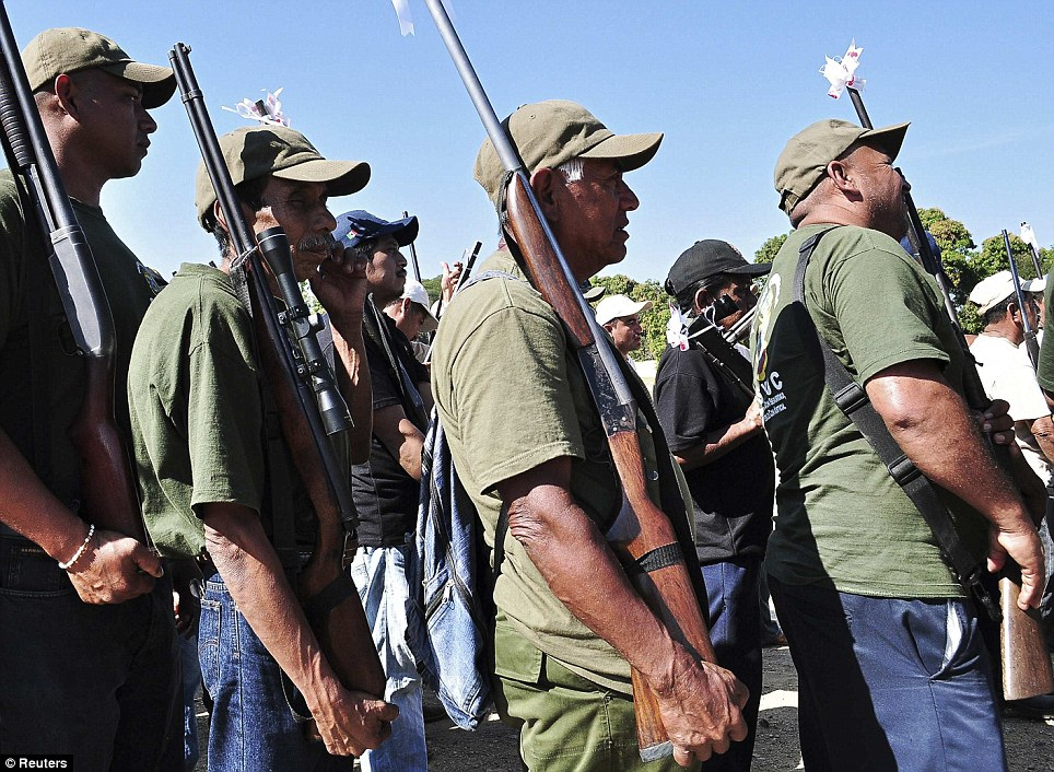In neighbouring Guerrero state members of the Public Safety System (a community police organisation) marched in honour of their first anniversary