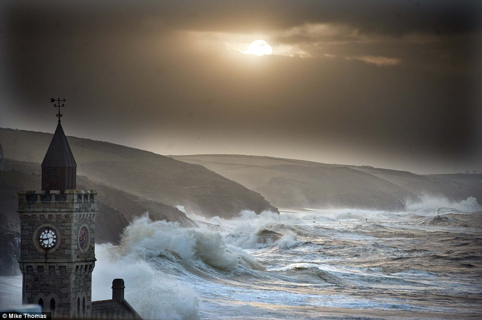 Splash: Porthleven in Cornwall today. Britain was again being battered by strong winds and large waves today as coastal communities braced for further flooding