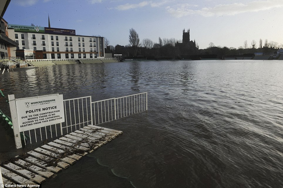 No play today: Strong winds and more rain sustain flooding around the Worcestershire County Cricket Club's ground in Worcester