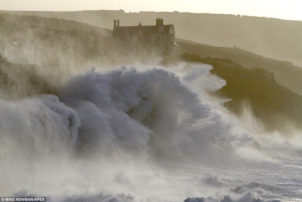 Huge: Colossal waves batter the Cornish coast at Porthleven. Officials around the country have pleaded with people to keep away from the storm-hit coasts