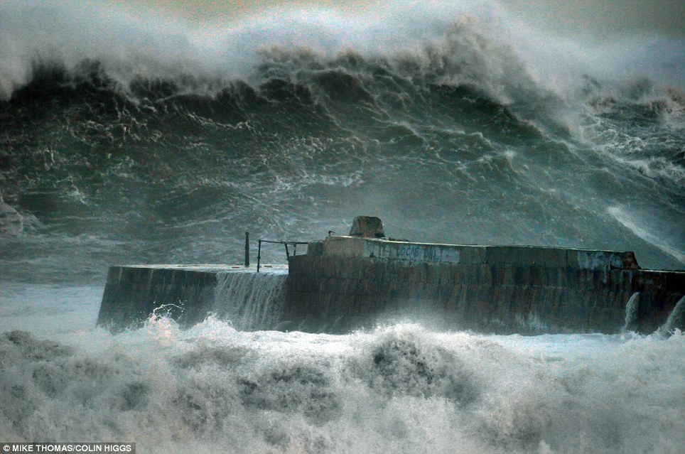 Destruction: The 18th-century pier at Portreath minus its 'monkey house' - a small stone hut - which was washed away by the massive Atlantic breakers this morning