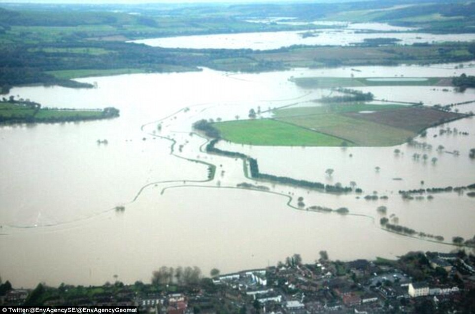 From above: An aerial view of flooding on the lower River Arun floodplain in Sussex, which was taken by the Environment Agency Geomatics team