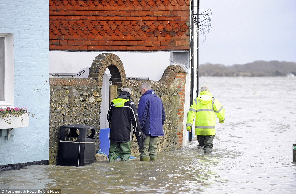 Looking at the damage: The weather brought the sea into Langstone High Street in Havant, near Portsmouth, Hampshire