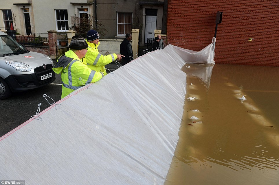 Doing its job: A 4ft emergency barrier was all that stood between the people of Avon Crescent and the rising river in Bristol