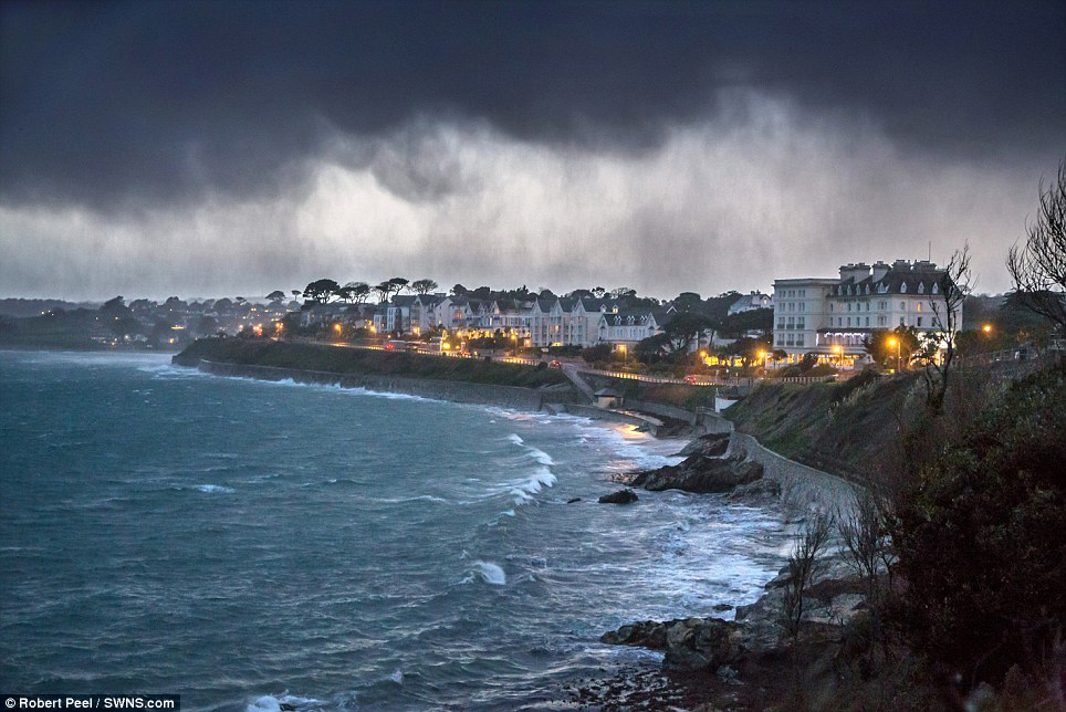 Like a painting: A storm approaches the seafront at Falmouth, Cornwall, just after sunset last night