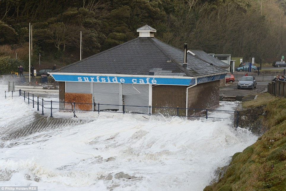 Not open for business: Stormy weather at Caswell Bay in Swansea, South Wales, as Britain is battered by high waves and strong winds