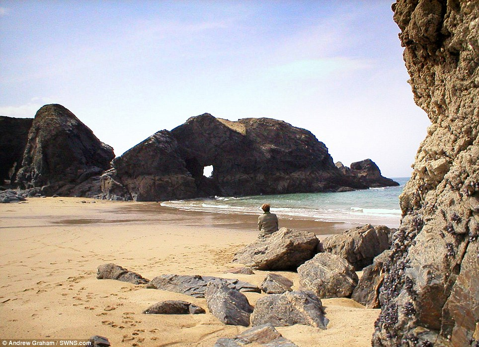 Before: The rock arch at Porthcothan Bay pictured in 2013 before it was destroyed by the recent storms