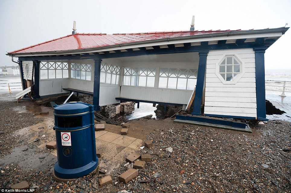 Time to leave: Students in halls of residence along the seafront had already been evacuated in preparation for more morning devastation at high tide