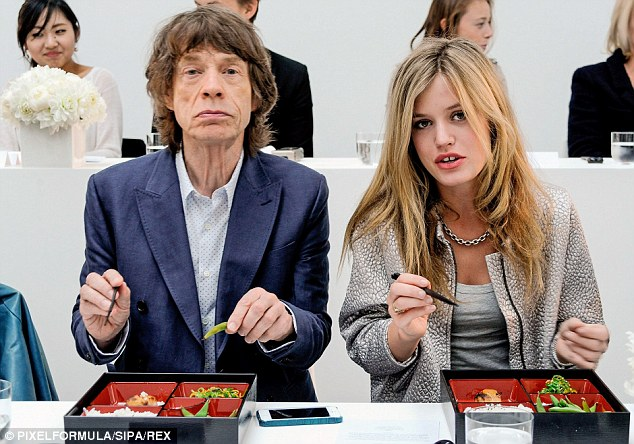 Famous father: Georgia May with dad Mick at the L'Wren Scott London Fashion Week show back in September