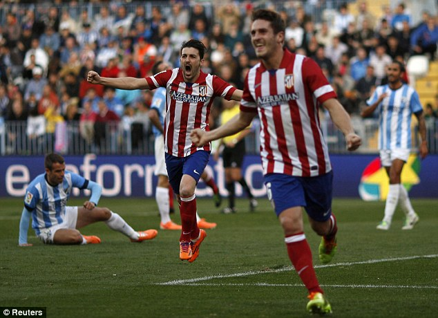 On the up: Atletico are Barcelona's main challengers for La Liga title as they approach the half way stage