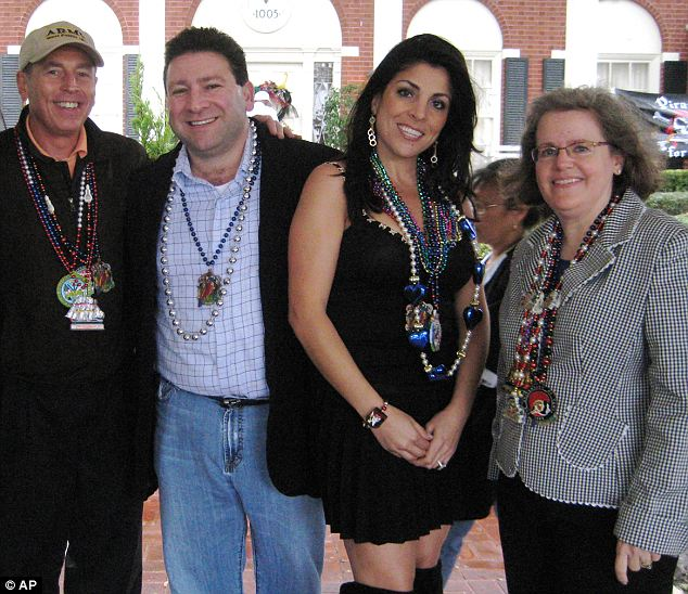 All friends: Jill Kelley and her husband Mark (center) hosted a number of parties in Tampa when David Petraeus (left) and his wife Holly (right) were stationed there in 2010 and the couples became friends