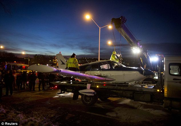 Drama: The plane that pilot Michael Schwartz daringly landed on the Major Deegan Expressway in the Bronx is removed from the scene