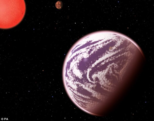 Earth's gassy twin as been discovered in another solar system 200 light years away. Pictured is an artist's impression of KOI-314c in orbit around its star. It orbits a dim red dwarf star at such a close distance that temperatures on its surface could be as high as 104°C