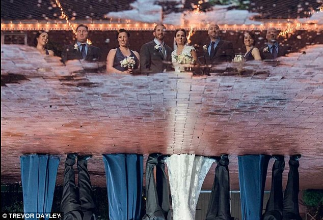 Mirror image: A wedding party made use of a storm by posing in the reflection made by a puddle