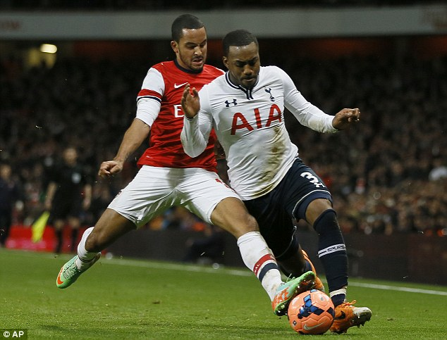 Clash: Walcott (left) sustained the injury in this challenge with Tottenham's Danny Rose