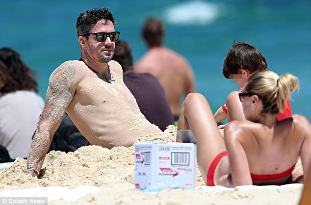 Fun in the sun: Pietersen takes his mind off the cricket by spending time with his wife Jessica Taylor